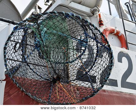 A big fishing cage on the boat