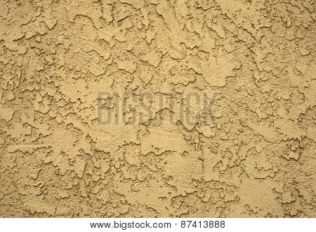 Concrete wall in grungy look with structure, reliefed concrete wall in yellow tones