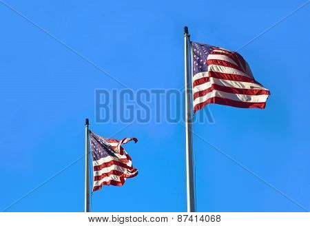 American flag waving on blue sly. Retro background. Fourth of July
