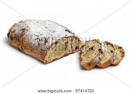 Traditional whole dutch easter bread covered with sugar and filled with almond paste on white background