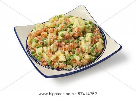 Traditional moroccan potato salad on a square dish on white background