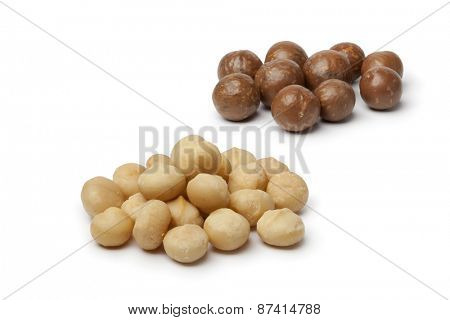 Peeled and unpeeled macadamia  nuts  on white background
