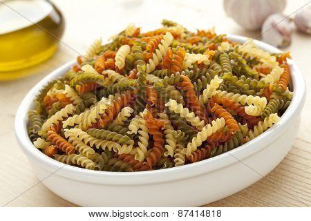 Traditional Italian fusilli tricolore in a dish