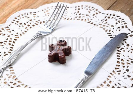 Chocolate man with fork and knife