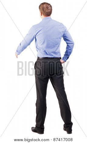 back view of businessman in red shirt out to shake hands. backside view of person. manager extends his hand in greeting. Isolated over white background. cocky office worker greets someone