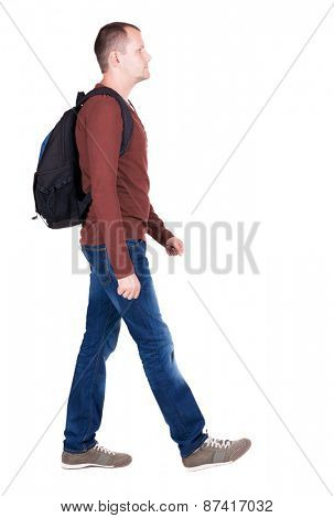 back view of walking  man  with backpack.backside view of person.  Rear view people collection. Isolated over white background. young man goes to side of a rolling travel bag on wheels