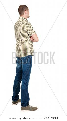 Back view of handsome man in shirt  looking up.   Standing young guy in jeans. Rear view people collection.  backside view of person.  Isolated over white background.