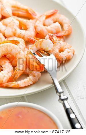 tasty prawns on plate and fork