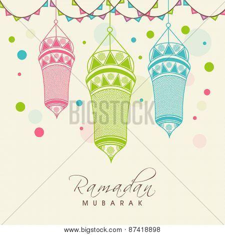 Floral decorated hanging colorful arabic lanterns for holy month of muslim community, Ramadan Kareem celebration