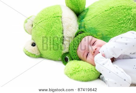 baby and frog toy