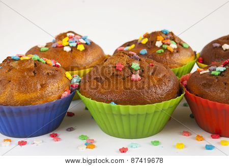 Muffins Decorated With Colored Powder