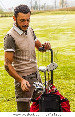 Classy Golf Player Choosing A Club