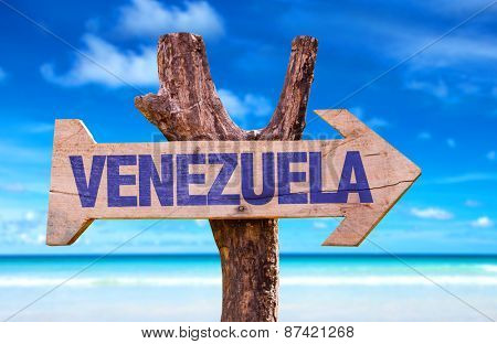 Venezuela wooden sign with beach background