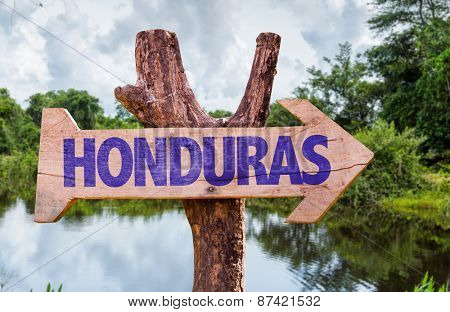 Honduras wooden sign with forest background