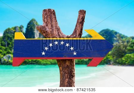 Venezuela Flag wooden sign with beach background