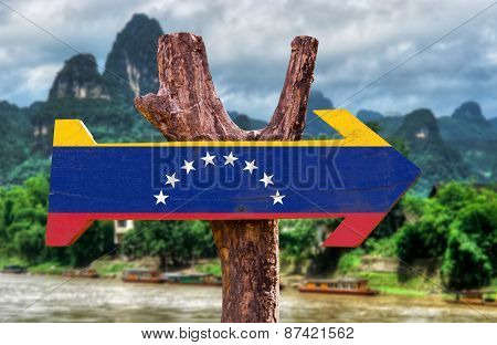Venezuela Flag wooden sign with countryside background