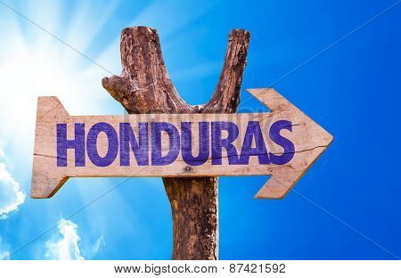 Honduras wooden sign with sky background