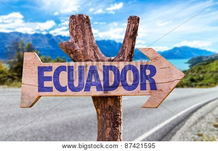 Ecuador wooden sign with road background