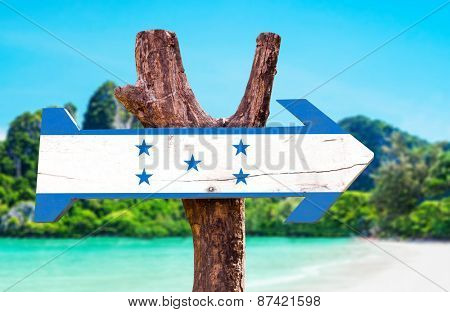 Honduras Flag wooden sign with beach background
