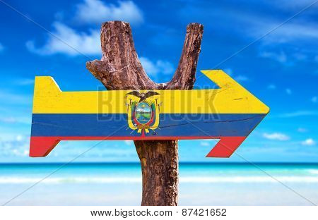 Ecuador Flag wooden sign with beach background