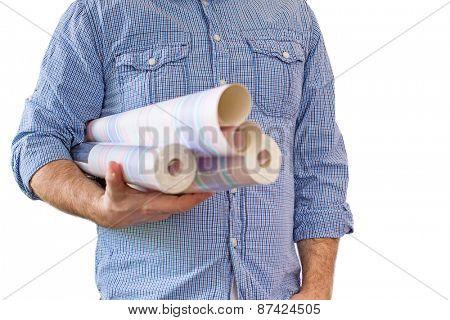 Handyman carrying rolls of wallpaper