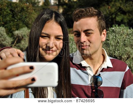 Young People Watching Their Mobile Phones