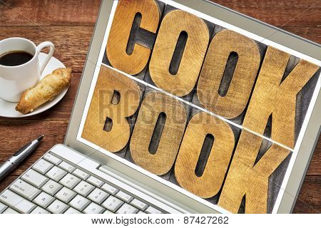 cookbook word abstract  - text in letterpress wood type on a laptop screen