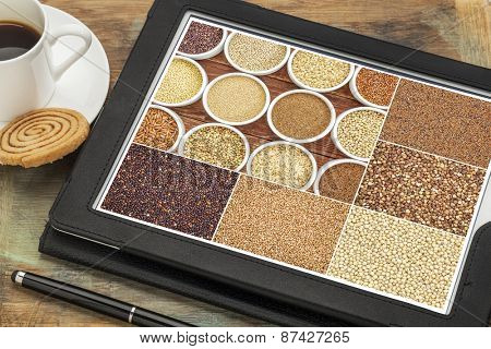 Reviewing pictures of healthy gluten free grains (quinoa, kaniwa, brown rice, millet, amaranth, teff, buckwheat, sorghum) on a digital tablet. All screen pictures copyright by the photographer.