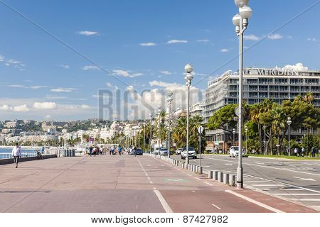NICE, FRANCE - OCTOBER 2, 2014: English promenade (Promenade des Anglais) runs along city's waterfront between comfortable beaches and luxury hotels.