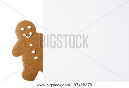 Gingerbread with happy smiling face with advertising board