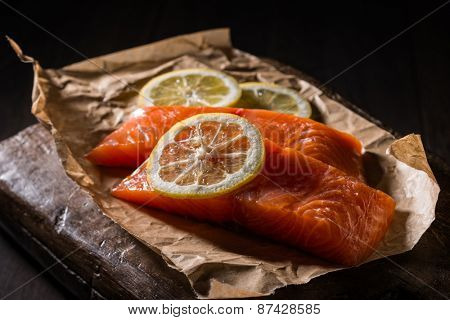 Salmon fillets and lemon slices with creative lighting