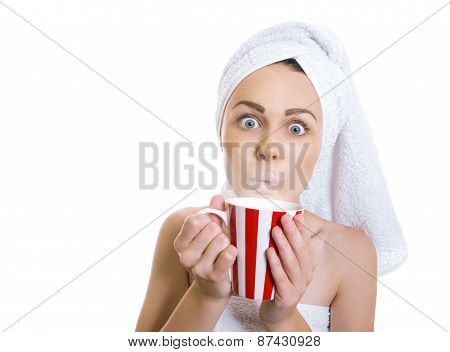 Funny Woman Wrapped In A Towel Drinking Hot Tea Or Coffee. Young Girl Holding Cup - Mug Of Dring, Is