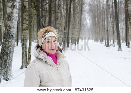 Portrait Of A Middle-aged Woman On The Background Of A Winter Alley.