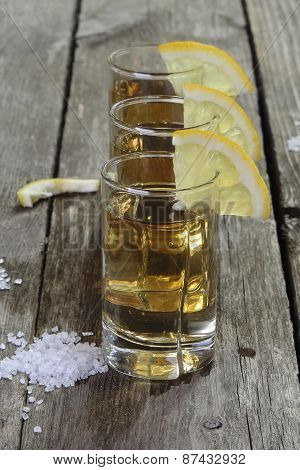Three Glasses Of Tequila With Lemon And Salt