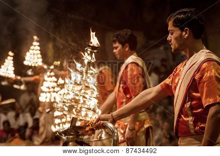 Varanasi, India - March 20, 2013: Unidentified young novices on Ganga Aarti ceremony in Varanasi, India