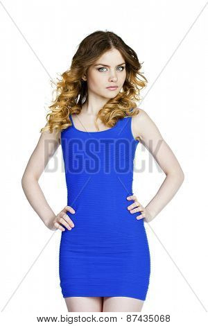 Beautiful young sexy woman in a blue dress posing on a white background