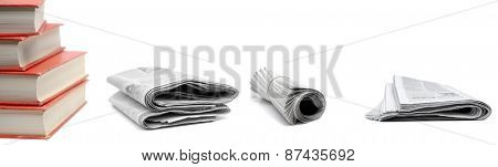 Stack of red books and newspapers isolated on white background