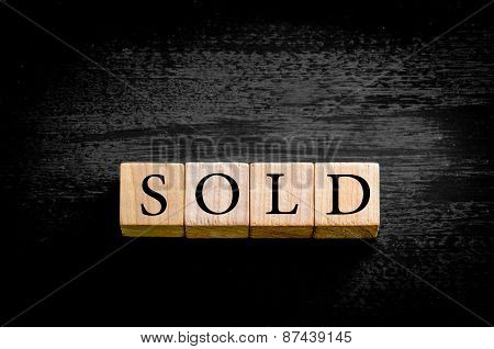 Word Sold Isolated On Black Background With Copy Space