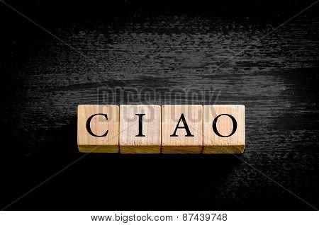 Word Ciao Isolated On Black Background With Copy Space