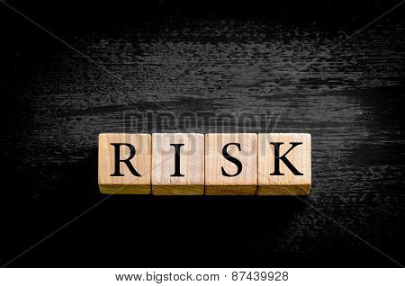Word Risk  Isolated On Black Background With Copy Space