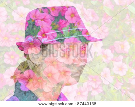 Double exposure with a girl wearing a hat and pink flowers