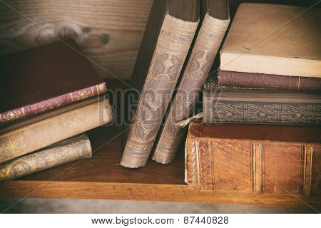 grunge wooden shelf with old books.