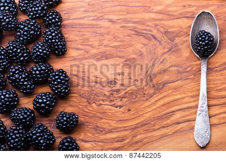 Blackberry On Wood With Spoon