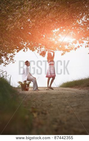 Happy attractive Young couple enjoying the outdoors together
