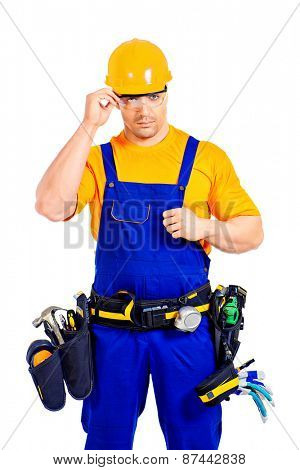 An industrial worker wearing uniform and tools. Job, occupation. Isolated over white.