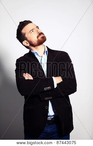 Thinking man isolated. Closeup portrait of a casual young pensive businessman looking up at copyspac