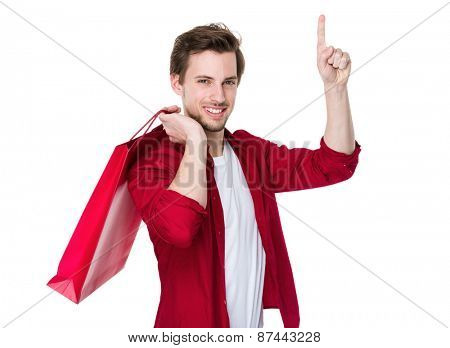 Happy Attractive Man carrying a Red Shopping Bag