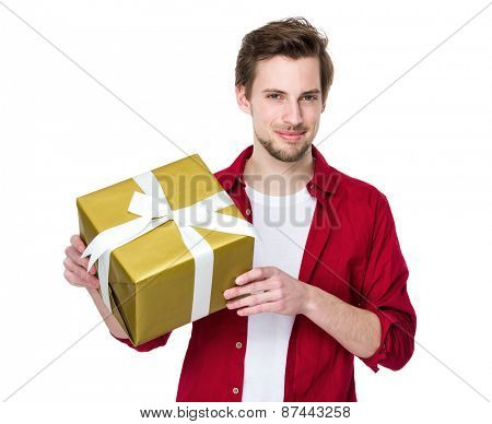 Young handsome man giving present gift box