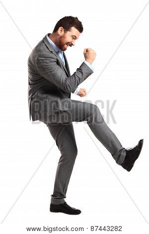 Excited handsome man with arms raised in success - Isolated on white