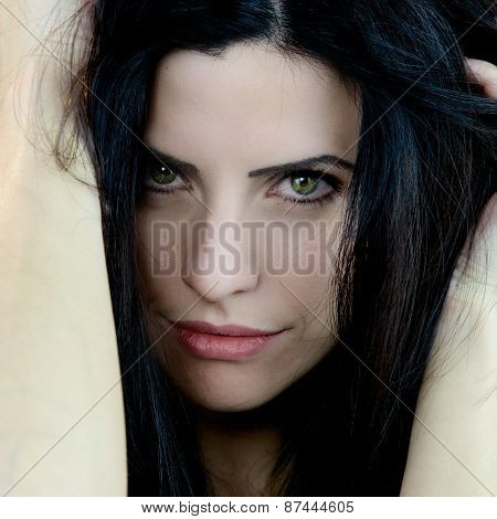 Portrait Of Beautiful Woman With Green Eyes